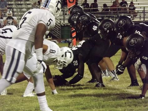 Varsity football battles Centennial Bulldogs for Thursday Night Lights