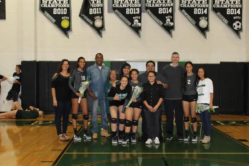 Seniors+Nickelle+Fleming%2C+Kanani+Fafard+and+Jalyn+Miller+stand+with+their+loved+ones+during+the+senior+night+game+on+Oct.+27