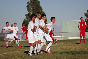 On Palo's home field junior Nolan Sherwood and seniors Matthew Thomas, Austin Polster and Jose Ahumuada block a free kick during a game against Arbor View on Sept. 30.