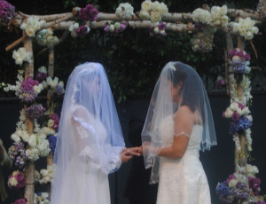 Two women exchange vows on June 8, 2013 in Beverly Hills, Calif. As they shared their most memorable moment with their visitors, they demonstrated happiness shouldn't have a law.