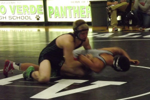 Senior captain Kayden Pierson pushes his opponent from Arbor View into the mat during a match that ended with his victory through points scored on Jan. 8 in the Palo Verde gymnasium.