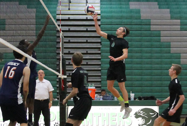 Senior and co-captain Parker Nelson jumps to spike the ball and earn a point for his team at the home game against Legacy on April 10.