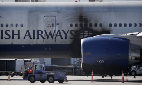 Plane catches on fire at McCarran International Airport