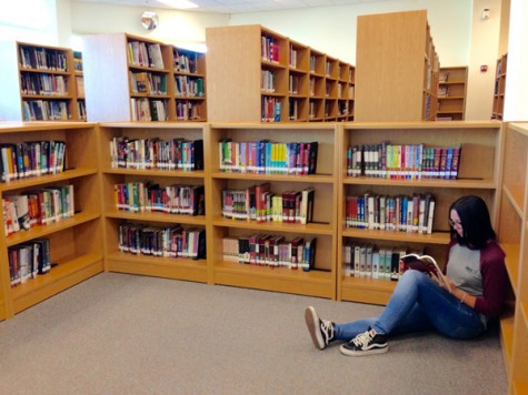 "Palo Verde junior, Savannah Gooding sits in the library reading ""Macbeth."""