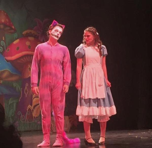 Junior Alexa Williams (playing Alice) and senior Luis Monteiro (playing the Chesier Cat) perform their scenes onstage during the Wednesday performance of
