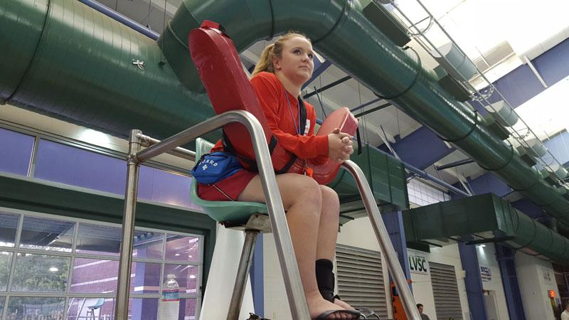 A high school graduate continues the job she's had as a lifeguard since she was a teen.
