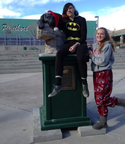 Senior Brandon Kincade and junior Holly O'Donnell pose with their pj's in front of the panther in the quad.