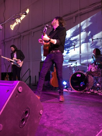 "Local band ""Brumby"" plays a show at the Charleston airplane hanger."