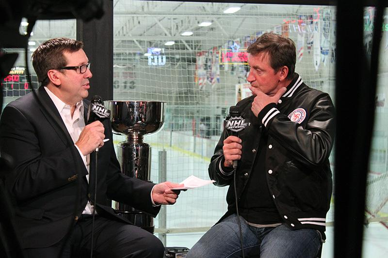 NHL Live reporter, EJ Hradek (L) and all-star hockey player Wayne Gretzky (R) sit down at Brooksy's Bar & Grill in Las Vegas, NV on March 23 for an exclusive interview.
