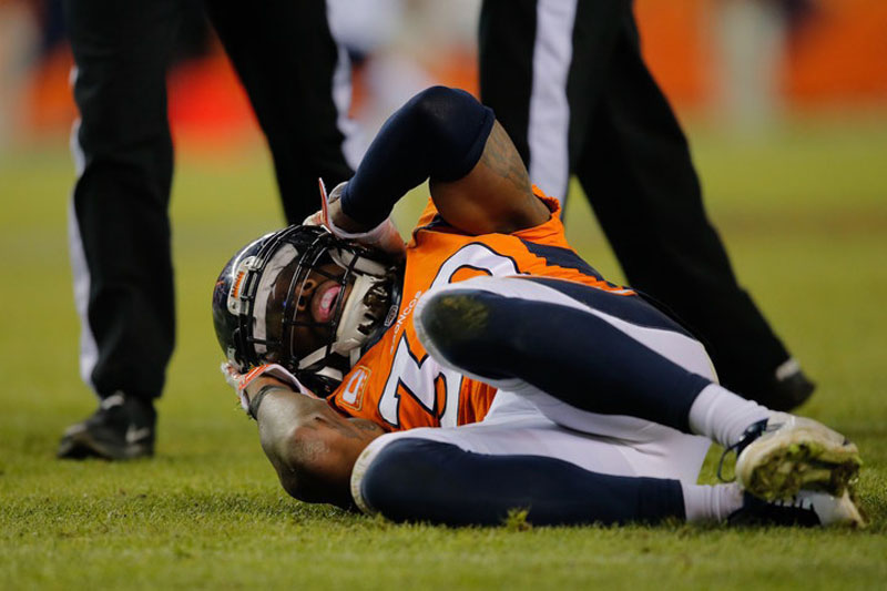 Strong safety David Bruton #30 of the Denver Broncos lies on the ground in pain after a play that would force him out of the game with a reported concussion during a game against the Oakland Raiders
